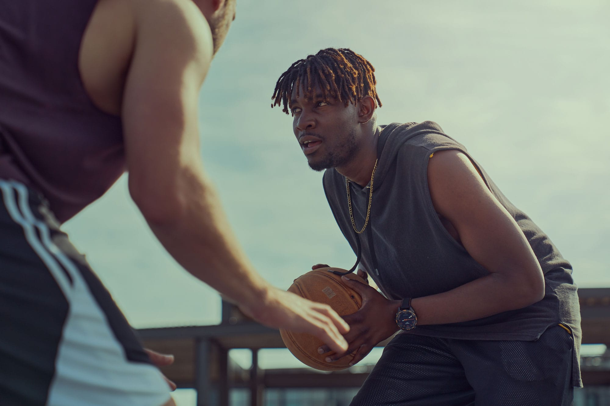 tissot product watch print campaign with basketball players playing one on one at the V&A Water Front Cape Town using natural lighting