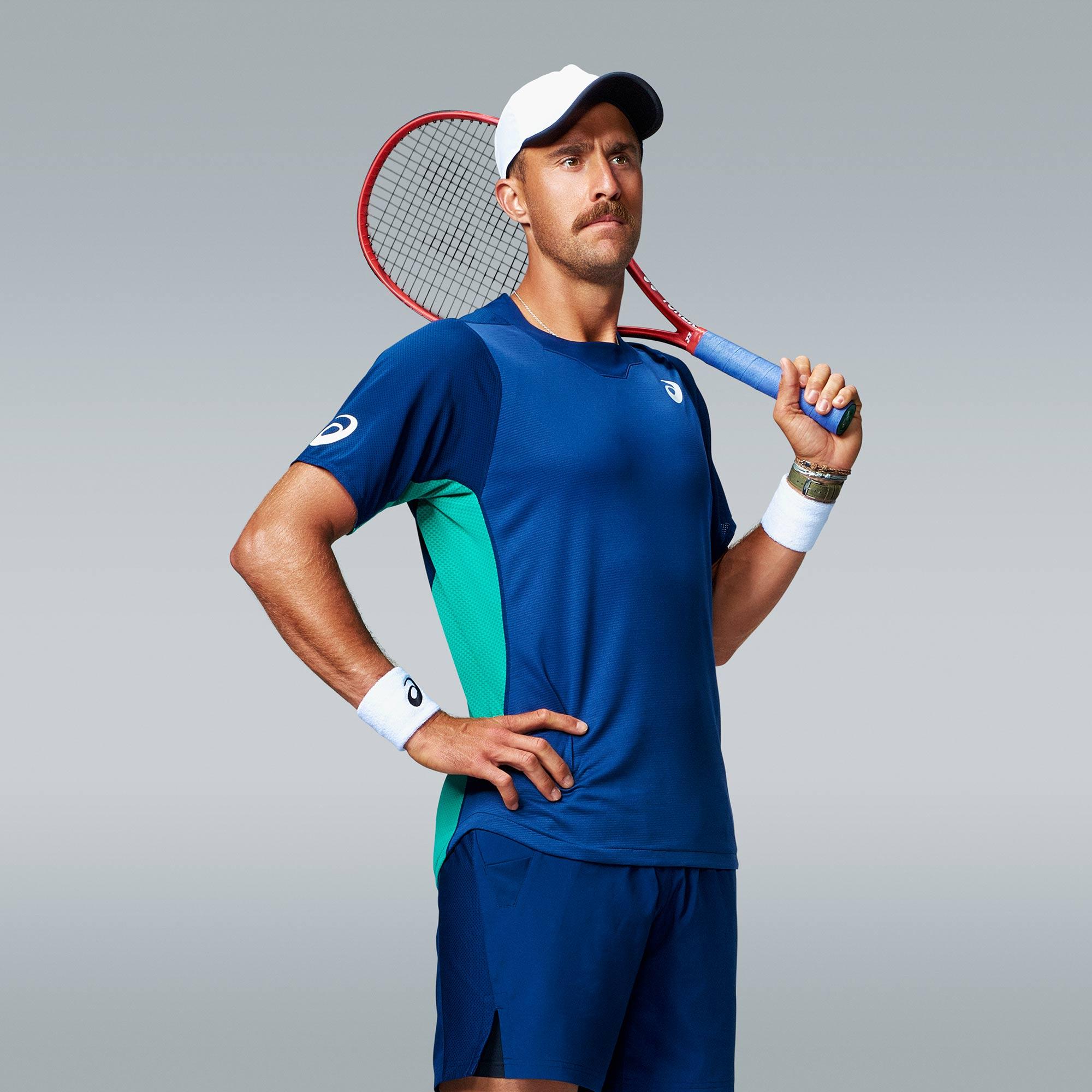 tennis player steve johnson possess for a portrait in studio using profoto flash photography